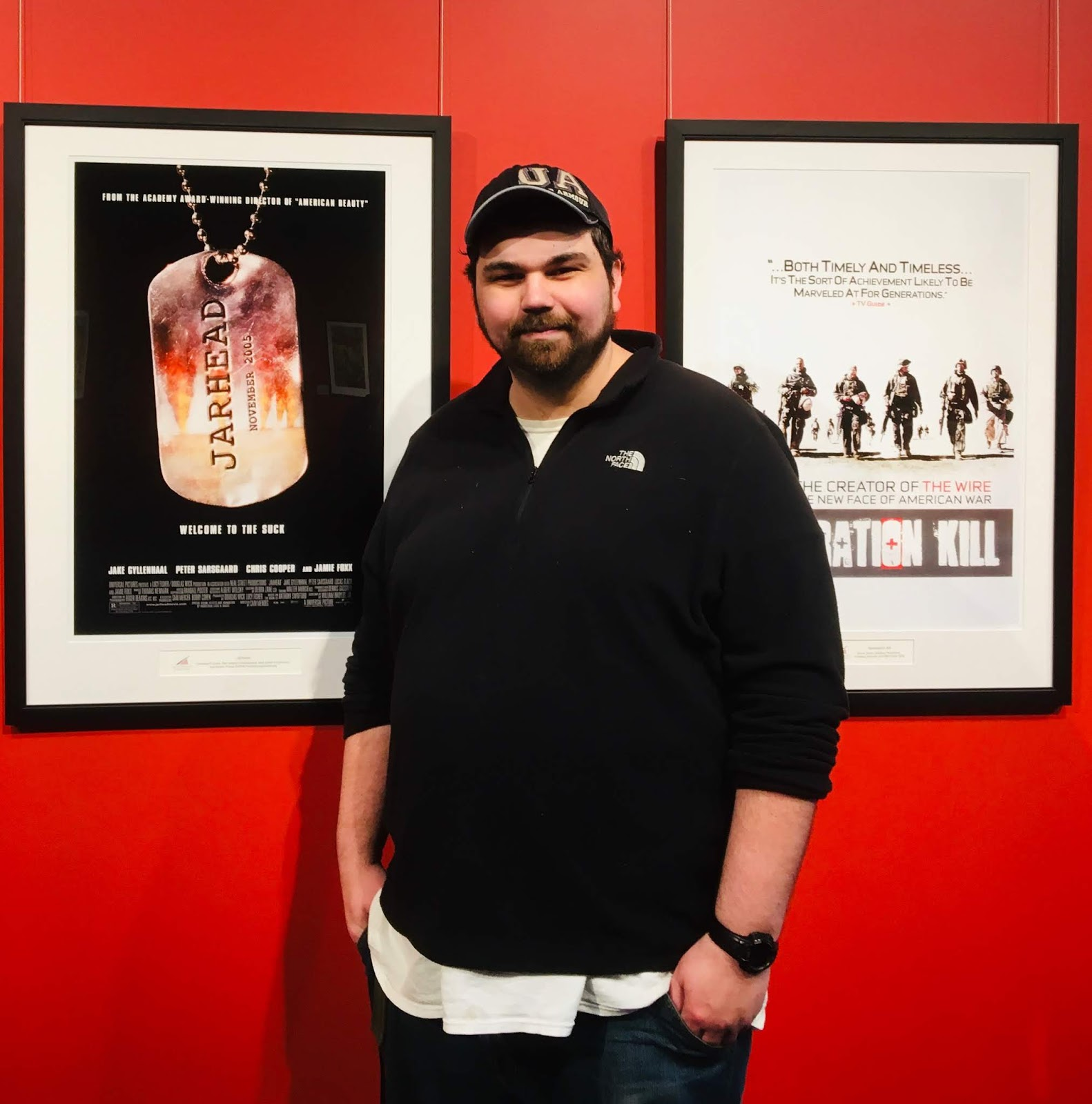 Man, Jeff Toplyn, Standing In Front of Movie Posters For Jarhead And Generation Kill