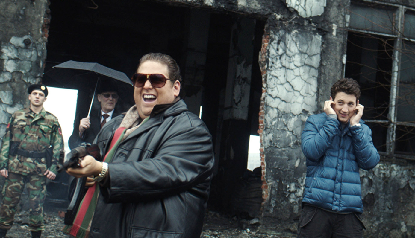 Actors from the movie War Dogs shoot machine guns