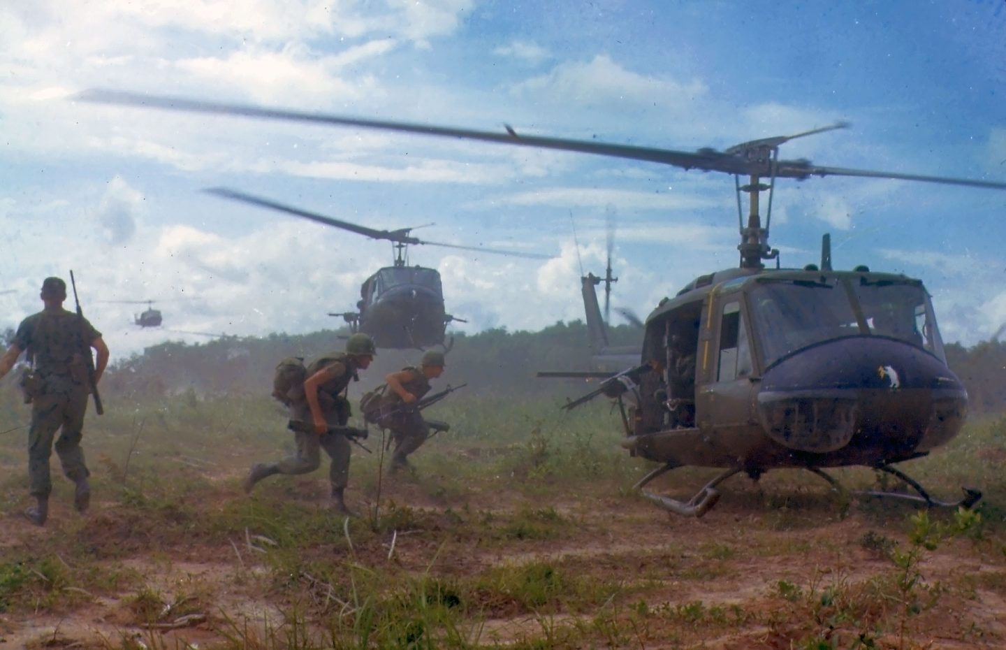 Soldiers running for the door of a helicopter in the movie Danger Close: The Battle of Long Tan