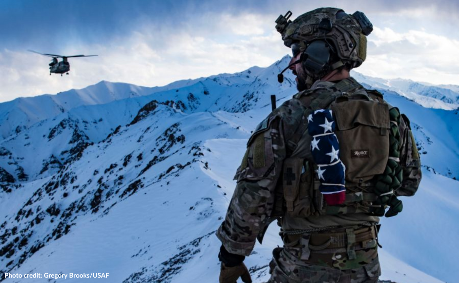 air force pararescueman looking at the mountains of Afghanistan