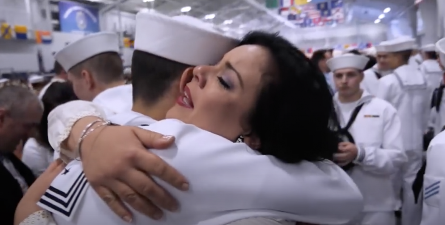 A proud mother embraces her son at U.S. Navy graduation
