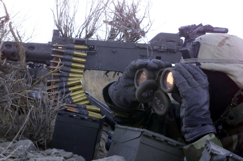 75th Regiment Army Ranger peers through binoculars during Operation Anaconda in Afghanistan