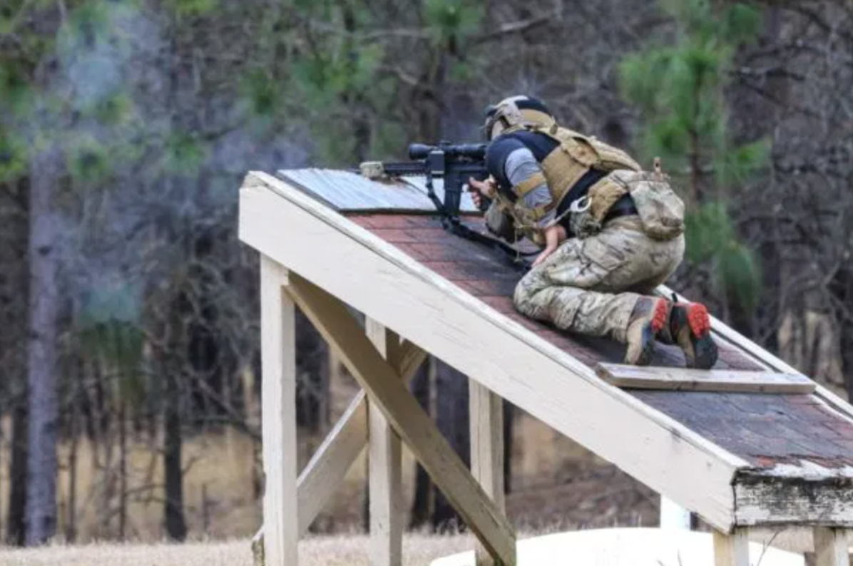 soldier shoots from a platform as part of the 10th annual sniper competition