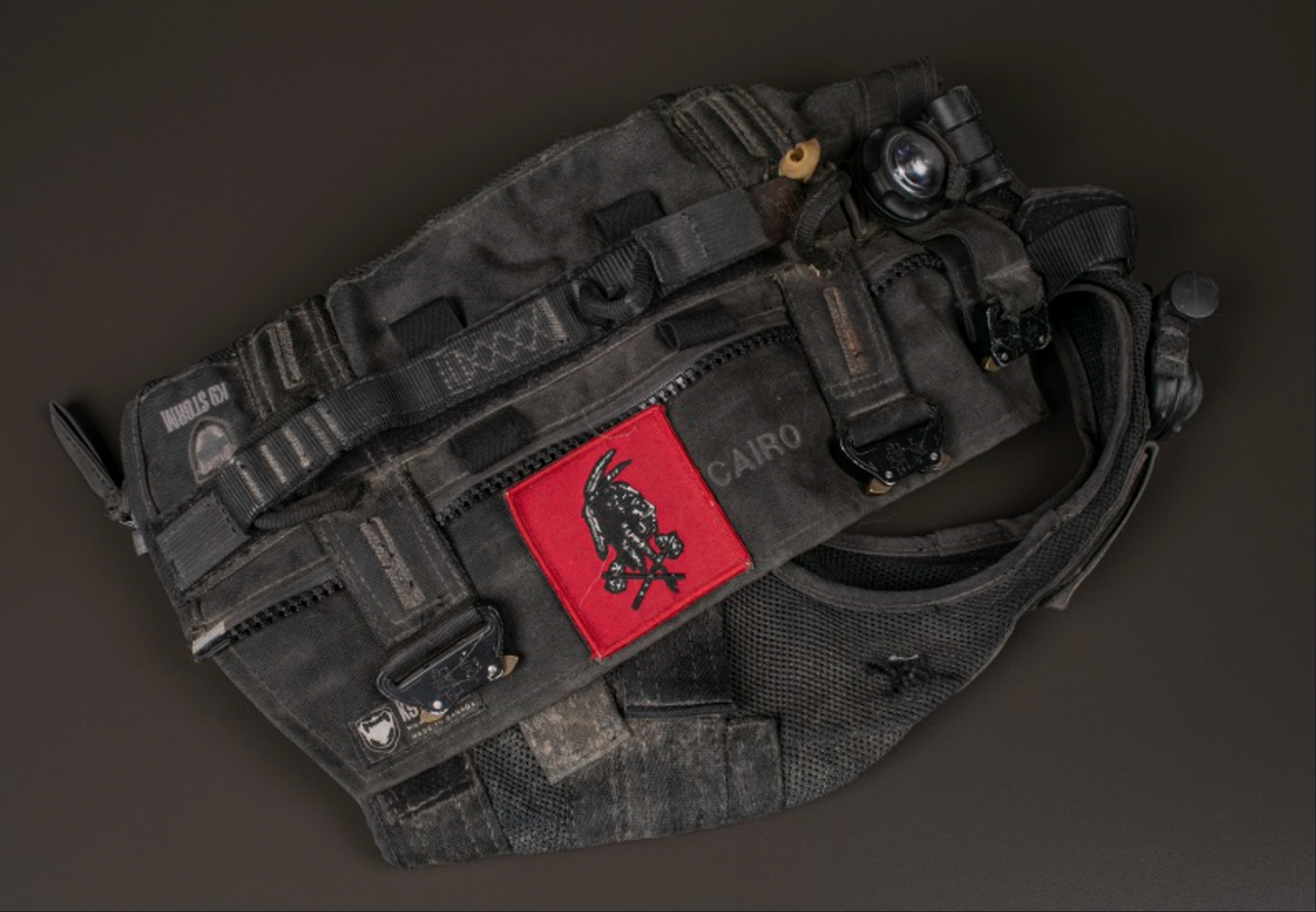 Photo of the combat vest worn by SEAL K9 Cairo during the raid on Osama bin Laden's compound